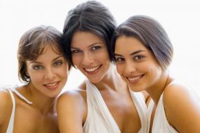 DENTIST IN SHAWNEE KS - Three women wearing white and smiling