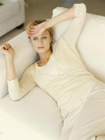 Woman lying on sofa, elevated view