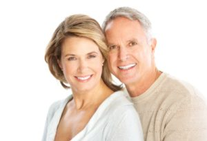 Dental Shawnee KS - An older couple smiling to show their veneers