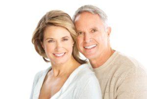 Dental Shawnee KS - An older couple smiling to show their veneers
