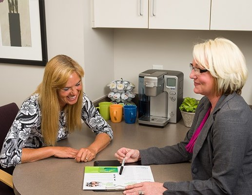 Our office manager going over financial options with a patient to show that Dr. Dervin, your dentist in Shawnee KS, has an incredible team to help work within your budget.